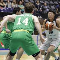 Japan's Tenketsu Harimoto carries the ball during Tuesday's 84-68 defeat to Australia at the FIBA Asia Cup in Zouk Mikael, Lebanon. | AFP-JIJI