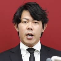 Giants pitcher Shun Yamaguchi speaks during a news conference on Friday in Tokyo.   KYODO