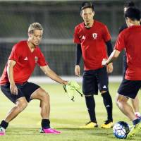 Keisuke Honda (left) takes part in a training session with his Japan teammates on Monday ahead of Thursday's World Cup qualifier against Australia in Saitama. | KYODO