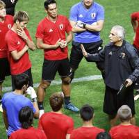 Japan coach Vahid Halilhodzic speaks to his team during a training session at Saitama Stadium on Wednesday. | KYODO