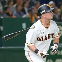 Former major leaguer Casey McGehee, who usually plays third base, is manning second base for the Yomiuri Giants now as the team tries to keep his bat in the lineup. | KYODO