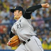 Minoru Iwata and the rest of the Hanshin staff are under pressure after the team lost its top two starters to injury in the past week. | KYODO