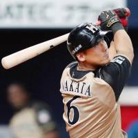 Hokkaido Nippon Ham's Sho Nakata hits a solo home run in the ninth inning of the Fighters' 7-1 win over the Hawks on Monday. | KYODO