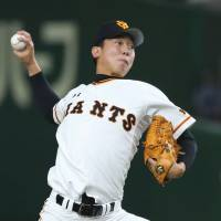 Yomiuri starting pitcher Seishu Hatake pitches during the Giants' 6-1 win over the BayStars on Sunday at Tokyo Dome. | KYODO