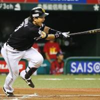 The Hawks' Nobuhiro Matsuda hits a tiebreaking single in the 10th inning of SoftBank's 8-7 win over the Lions on Saturday night at MetLife Dome. | KYODO