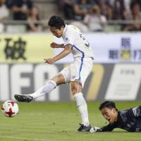 Kanazaki strikes twice to help Kashima rise to top of J. League