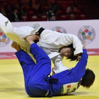 Ai Shishime (in white) takes on Natsumi Tsunoda in the final of the women's 52-kg competition at the judo world championships in Budapest on Tuesday. | AP