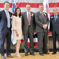 Tokyo American Club Olympic committee chair Dean Rogers (left), United States Olympic Committee chief marketing officer Lisa Baird (second left), Tokyo American Club president Mike Alfant (center), USOC CEO Scott Blackmun (second right) and Japanese Olympic Committee president Tsunekazu Takeda (right) pose for a photo at the Tokyo American Club on Wednesday. | KAZ NAGATSUKA
