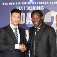 Ryota Murata and Hassan N'Dam shake hands at a news conference on Thursday in Tokyo announcing a rematch for the WBA middleweight title. | KAZ NAGATSUKA