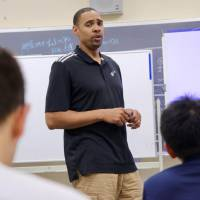 Utah Jazz assistant coach and former Japan Basketball League coach and player Antonio Lang speaks to Japanese coaches and administrators during Wednesday's seminar in Tokyo. | KAZ NAGATSUKA