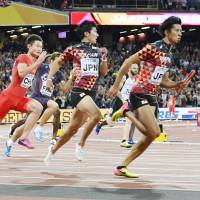 Sprinters Yoshihide Kiryu (second from right) and Kenji Fujimitsu helped Japan claim a bronze medal in the men's 4x100-meter relay at the IAAF World Athletics Championships last weekend in London. | KYODO
