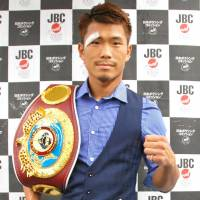 WBO flyweight champion Sho Kimura poses for photos during a news conference on Friday. | KYODO