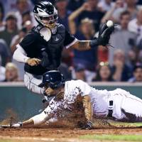 Boston shortstop Xander Bogaerts, seen here scoring against the Chicago White Sox last week, is just one of the young guns who have helped power the Red Sox into first place in the AL East. | AP