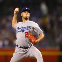 Darvish, sluggers guide Dodgers past Diamondbacks