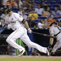 Stanton keeps homer streak alive before Marlins cough up late lead