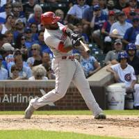 Reds jump out to 9-0 lead, hold off Cubs in slugfest