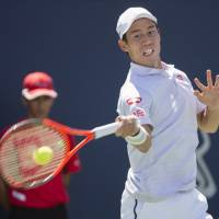 Kei Nishikori hits a return against Gael Monfils during the second round of the Rogers Cup in Montreal on Aug. 9. On Wednesday, Nishikori announced he will miss the remainder of the season because of a wrist injury. | AP