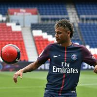 Neymar arrives at PSG, says money wasn't motivation for move to France