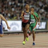 Abdul Hakim Sani Brown runs during the 100-meter heats at the IAAF World Championships on Friday in London. | AP