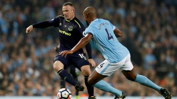 Rooney scores 200th goal in draw