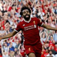 Liverpool thrashes Arsenal; Burnley holds Spurs to draw