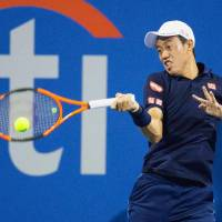 Kei Nishikori plays a shot during his second-round win over Donald Young of the United States at the Citi Open in Washington on Tuesday. | KYODO