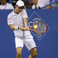 Nishikori survives, makes semis