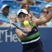 Top seeds advance on day filled with upsets