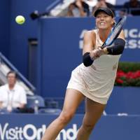 Sharapova battles past Babos in three sets; Zverev ousted