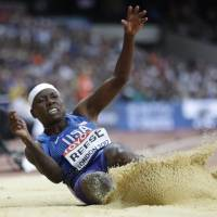 American Brittney Reese competes in the long jump final at the world championships on Friday. Reese won with a leap of 7.02 meters. | AP
