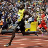 Bolt guides Jamaica into 100-meter relay final for grand farewell