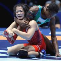Okuno captures gold in 55-kg class at worlds
