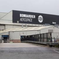 The Bombardier headquarters and factory are pictured in Belfast on Wednesday. The U.S. Commerce Department on Wednesday said it would impose anti-dumping duties of 220 percent on Bombardier's CSeries jets, following an investigation into state subsidies sparked by a Boeing complaint. | AFP-JIJI