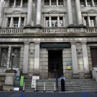 BOJ keeps policy unchanged but new member casts dissenting vote