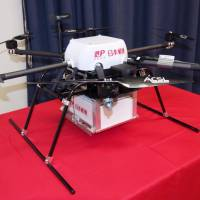 Japan Post Co. is considering using drones like this to move packages between post offices amid the shortage of delivery workers. | KYODO