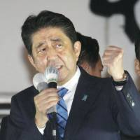 Prime Minister Shinzo Abe gives a speech in Tokyo's Shibuya Ward on Thursday after the Lower House was dissolved earlier that day. | KYODO