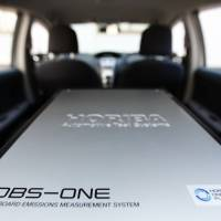 A Horiba Ltd. OBS-ONE portable emissions measurement system sits in the trunk of a car at the company's headquarters in Kyoto. | BLOOMBERG
