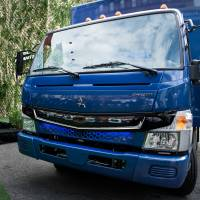 The Mitsubishi Fuso eCanter truck is unveiled during a launch event in New York on Thursday. | BLOOMBERG
