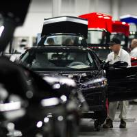 Honda workers assemble cars at the company's Marysville plant in Ohio. The carmaker is investing $267 million and adding 300 jobs at two Ohio factories. | BLOOMBERG