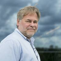 Eugene Kaspersky, Russian antivirus programs developer and chief executive of Russia's Kaspersky Lab, poses for a July 1 photo on a balcony at his company's headquarters in Moscow. On Wednesday, the U.S. banned the use of computer software supplied by Kaspersky Lab at federal agencies because of concerns about the company's ties to the Kremlin and Russian spy operations. | AP