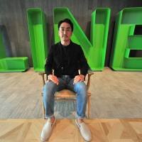 Line CEO Takeshi Idezawa poses at his office in Shinjuku, Tokyo, on Aug. 8. The maker of Japan's most popular messaging app says the future of its business is AI.   YOSHIAKI MIURA