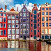 Iconic canal-side homes are seen in Amsterdam. Mitsubishi UFJ Financial Group Inc. is said to have chosen the city as its base for investment banking in the European Union after Brexit. | ISTOCK