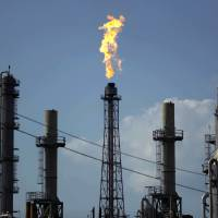 A flame burns at the Shell Dear Park oil refinery Thursday in Dear Park, Texas. While it's nowhere close to record highs, retail gas, as expected, began increasing in the wake of Hurricane Harvey's devastation that has affected Texas refinery production. | AP