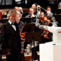 Robot 'conductor' steals show from Italy's top tenor Bocelli but can't improvise