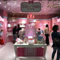 People look at the new Sailor Moon store in Tokyo's trendy Harajuku district during a media preview Saturday morning. It opened to the public later in the day. | KAZUAKI NAGATA