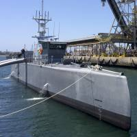 The Sea Hunter, a self-driving U.S. Navy ship, sits at a maritime terminal in San Diego in 2016. The Pentagon is testing the unmanned surface vessel designed to travel thousands of miles out at sea without a single crew member on board. | AP
