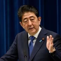 Sales tax to be hiked in 2019 unless disaster strikes, Abe says