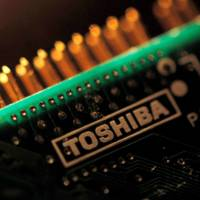 Toshiba Corp. selected a group led by Bain Capital as the buyer of its memory chip business, sources said Wednesday. | REUTERS