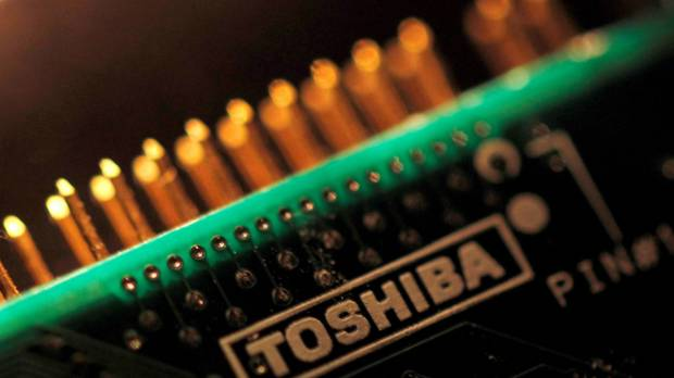 Toshiba selects Bain-led group for chip unit sale, looks to get out of debt by next March