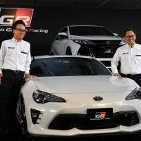 Gazoo Racing President Shigeki Tomoyama (left) and Toyota Motor Corp. President Akio Toyoda introduce the carmaker's new sports car brand, the GR series, Tuesday in Tokyo. | YOSHIAKI MIURA